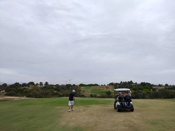 Hitting the second shot into the 8th green at Boavista golf club