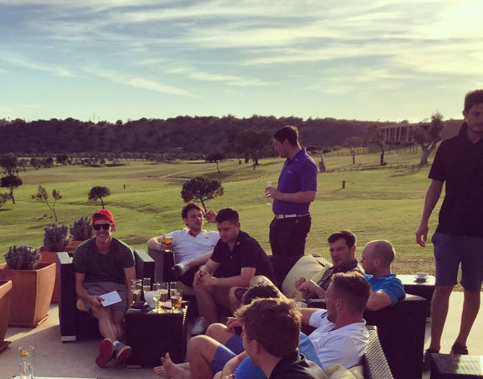 Group of golfers sat having a drink at a clubhouse in Portugal