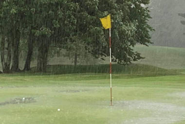 torrential rain on golf course green